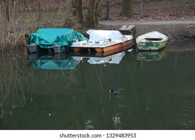 Parked boat floating on a calm lake