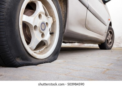 Parked car with deflated tire