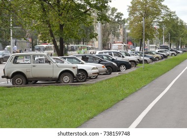 Parked cars on a city street. Editorial image. Novokuznetsk, Kemerovo region, Russia. 08 Aug 2017. The number of parked cars located on the diagonal of the image.