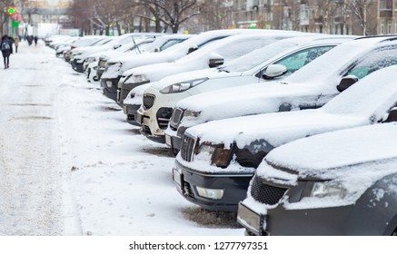 Parked cars in the winter on the street