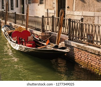 parked gondola by the canal in Venice Italy