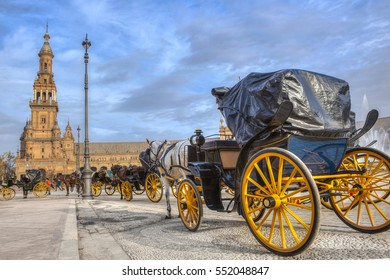 Parked Horse drawn carriages at Plaza de Espana in Seville, Andalusia, Spain. Spain Square