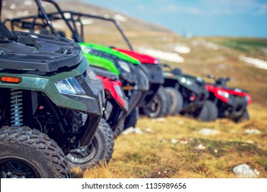 parked in a row several atv quad bikes extreme outdoor adventure concept