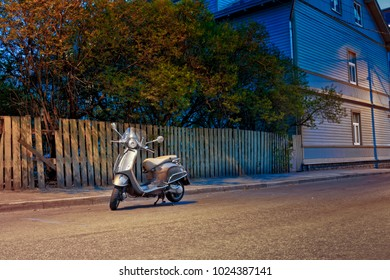 A parked scooter at a lonely street in Tallinn, Estonia. The capital of Estonia is a very safe city and you can leave your vehicles on the streets for the night.