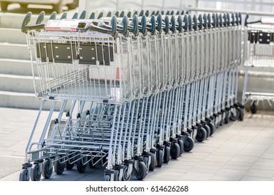 Parked Shopping Carts Outside Big Shop Closeup Shot Purchase Concept