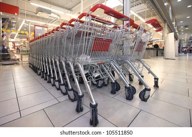 parked shopping carts in a supermarket
