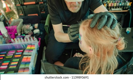 Parker, Colorado, USA-June 9, 2018 -  Face painting booth at the small town canival.