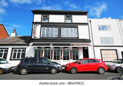 PARKGATE, WIRRAL - SEPTEMBER 18, 2016: Restaurant. Parkgate is a village on the Wirral Peninsula, situated on the coastline of the River Dee, adjoining 100 square kilometres of salt marsh.