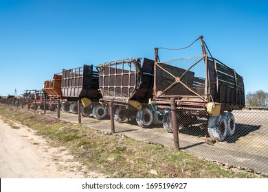 Parking agricultural machinery and harvest. rows of plows, cultivators, bodies