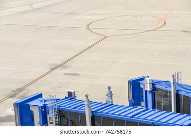 Parking area with areobridge for boarding passenger to airplane in the airport with copy space - transportation industry