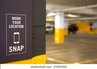 Parking area with sign of Mark Your Location and snap with handphone at open parking area that everybody can access. No property release is required.