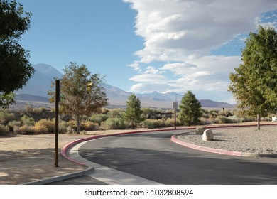 parking bay turning point in scenic idyle in nevada usa road trip vacation with a beautiful view to landscape to rest.cartoon look, picturesque colors. empty street turn with quiet rest area