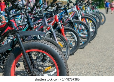 Parking of brand new teenager's bicycles on asphalt, sale