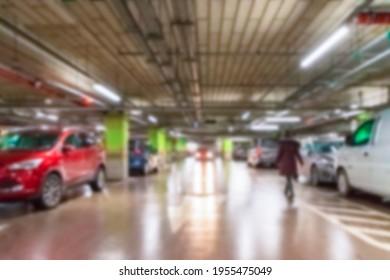 Parking car blurred. Empty road asphalt background in soft focus. Car lot parking space in underground city garage. Interior underground carpark