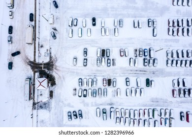 parking cars covered with snow after snowfall. aerial top view