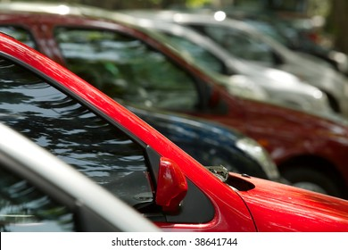 Parking cars, focus on the red one