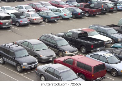 A parking lot crammed with cars. All trademarks have been removed.