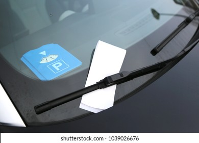 Parking disk under the windshield and the form is fine under the car wipers. Place for text.