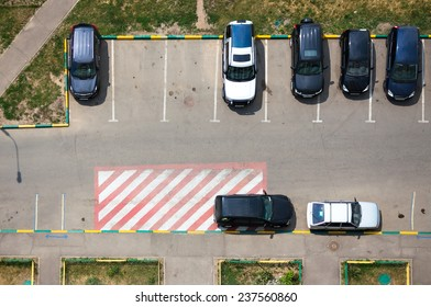 Parking in front of multi-storey building