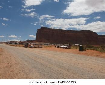 Parking lot full of cars and RVs at Monument Valley Navajo Tribal Park entrance - Arizona