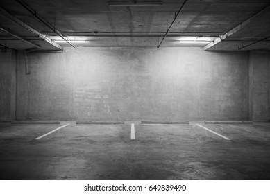 Parking garage department store interior with blank billboard.