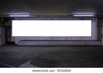 parking garage underground  interior with blank billboard.Empty space car park interior at afternoon.Indoor parking lot.interior of parking garage with car and vacant parking lot in building.
