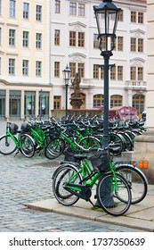 Parking for green bicycles for rent on Dresden square