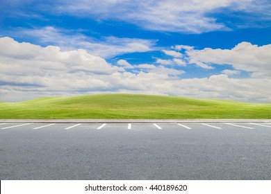 parking lot, parking lane outdoor with green grass and beautiful blue sky background