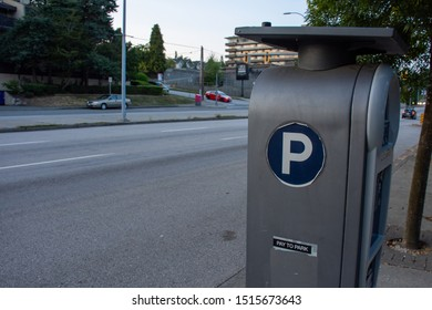 Parking Meter on the side of the road or street to park and pay in coins in downtown. Canada.