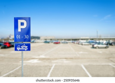 Parking lot with number of authoriszd parking sign with tow tru