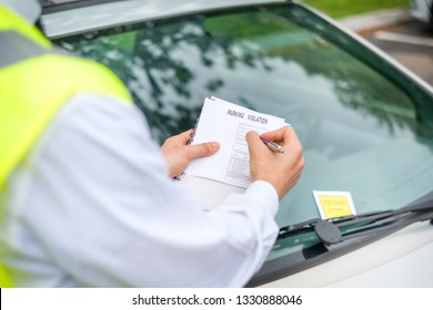Parking officer writing parking charge notice time limit