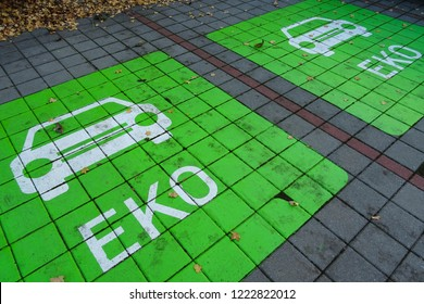 parking place for electric vehicles in green ecological color (text translation: Eko means Eco in English)