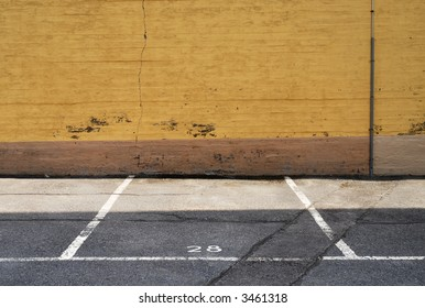 parking place next to a yellow wall