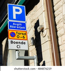 Parking provisions sign with text: Fee for Red ticket, Forbidden to parking Thursday between 0 am - 6 am, resident Ci