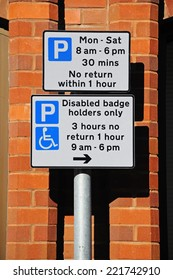 Parking restrictions sign.