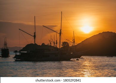 parking of ships.city port.Wild islands of Indonesia. Flores tropical paradise. sunset in Labuan Bajo. Wild beaches, blue logons, coral reefs, green hills. aerial view. boat trip safari. harbor