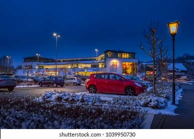 Parking lot and shopping mall in winter at night, Tutzing, Bavaria, Germany, Europe, 08. February 2018