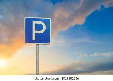 parking sign close-up on sky background