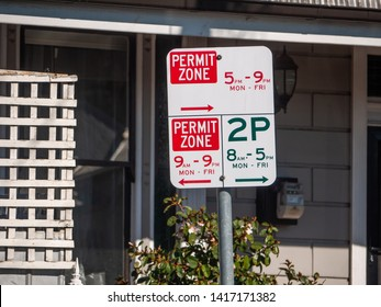 Parking sign in Melbourne's suburban neighbourhood street. Local residents need to display a permit from council to park in a particular permit zone.