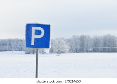 Parking sign in snow covered countryside
