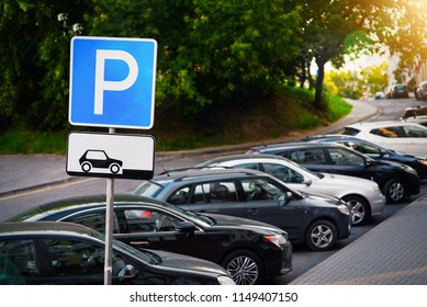 Parking sign. Vehicles take up way too much space in cities. Metropolis parking problems. Crowded parking.  Cars became biggest problem for urban ecology due emission and environmental pollution.