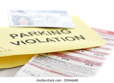 Parking ticket with drivers license and envelope