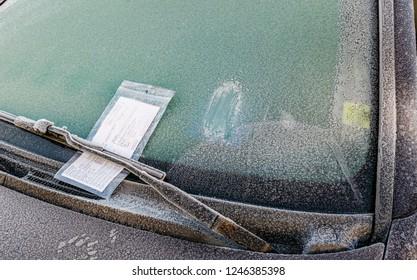 Parking ticket on frozen windshield
