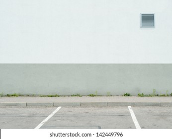 Parking lot wall and sidewalk