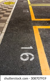 Parking lot with yellow line and slot number