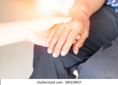 Parkinson and alzheimer female senior elderly patient with caregiver in hospice care.