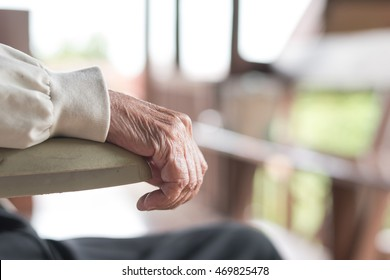 Parkinson disease patient, or Alzheimer elderly senior person in support of nursing family caregiver for disability awareness day concept