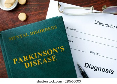 Parkinsons disease  concept. Diagnostic form and book on a table.
