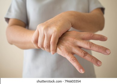Parkinson's disease symptoms. Close up of tremor (shaking) hands of Middle-aged women patient with Parkinson's disease. Mental health and neurological disorders.