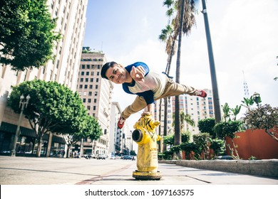 Parkour man doing tricks on the street - Free runner training his acrbatic port outdoors